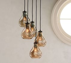 Alana Luster Glass Pendant - Smoke | Pottery Barn. same old idea, assorted lengths of long pendants hanging from wires, but this time in a tear drop shape.