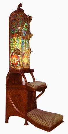 Joan Busquets i Jané (1874-1949) - Prayer Stool. Carved Mahogany, Gilt Brass, Leaded Glass with Upholstered Pads. Barcelona, Spain. Circa 1900.
