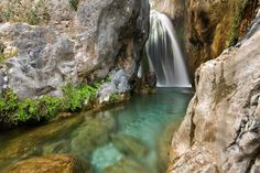 Les Fonts De L'Algar in Spain.  Went hiking/swimming here when we got engaged May 2008.    A beautiful set of cascading waterfalls just inland from the Costa Blanca in Spain. A visit to these magnificent waterfalls will leave you with memories of Mother Nature at her most powerful. Water gushes from every rock and cascades down onto turquoise glass pools of the deepest and clearest water.