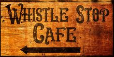 "A sign leading to the famous Whistle Stop Cafe in Juliette, Ga. The Whistle Stop Cafe was featured in the classic film ""Fried Green Tomatoes"" starring Kathy Bates, Mary Louise Parker, and Jessica Tandy."