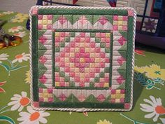 Laura Perin Grandma's Flower Garden quilt-inspired needlepoint in various DMC perle cottom #5
