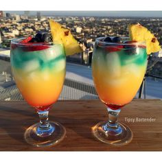 """TIPSY BARTENDER on Instagram: """"▃▃▃▃▃▃▃▃▃▃▃▃▃▃▃▃▃▃▃▃▃▃▃▃ Tropical and potent! It's the RAINBOW BREEZE! Click on the link in my bio to watch us make this one on youtube! Created by: @bread_man32 Post your original recipe and photo on Instagram using #TipsyBartender and we will repost the best ones. Each month, the pics with most likes wins $300, 2nd Place $200, 3rd Place: $100. #drinkporn #cocktail #foodporn #cocktails #liquor #alcohol #booze #club #bar #drink #mixology #drinkup #yummy…"""