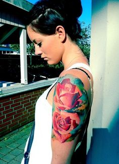 Red Roses Tattoo on Arm; this is like what I want. I love the vibrant colors and the size is perfect.