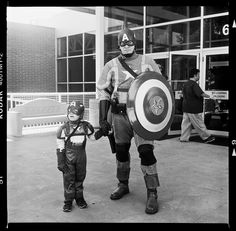 Captain America and Captain America Jr. by maxmfoto, via Flickr | street scene people + costume + black white grey + iphoneography