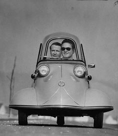 tes ago Photo by Ralph Crane - Front shot of two men riding in the three wheeled German made Messerschmidt. 1954.