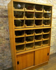 Oak Drapers Display Shirt Cabinet at D and A Binder | We have a range of gorgeous haberdashery shirt cabinets at Binder's! It has 24 pull out drawers behind sliding glass doors as well as sliding oak doors on the base. This cabinet would be perfect in retail as well as in museums fabric stores and other displays. We specialize in these rarer shirt cabinets so if you would like to see more of our display items have a look at DandABinder.co.uk or email us at david@dandabinder.co.uk for…