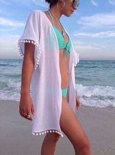 Cool White Beach Cover up! Soft, Soothing to a sun kissed skin, totally breathable the gauze cover up is a must for any beach vacation or outfit upgrade. Matching pom poms are added to the sleeves and the bottom White Beach Cover Up, Beach Covers, Bikini Cover Up, Swimsuit Cover Ups, Strand Kimono, Outfit Strand, Mode Du Bikini, Bikinis, Swimsuits