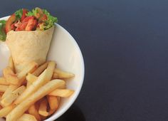 A delicious meal in a wrap. Hearty and mouth-watering, tender Tandoori Chicken, seasoned in good stuff like fresh ginger, tomato paste, hot paprika and garlic. Wrapped up in a soft flatbread with some cilantro-flecked Greek yogurt and crunchy veggies. Served with French fries from our Kembang Goyang Restaurant. ‪#‎DiscoveryAncol‬ ‪#‎chicken‬ ‪#‎tandoori‬