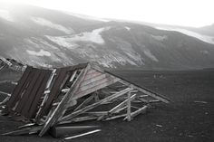 "Abandoned Whaler's Hut  Deception Island, an active volcano in the S. Shetland Islands off Antarctic Peninsula, was used by sealers in 19th cent. taking refuge from storms & passing icebergs, INSDIE the blown out caldera. A permanent whaling/research station, Port Foster, was established in early 20th century until 1969 when it was abandoned after a massive earthquake. With ""wildly varying microclimates"" it's a great place to take a heart stopping dip in Antarctic waters of Whaler's Bay"