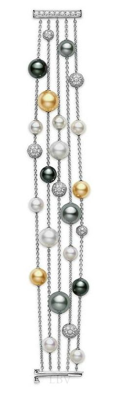 Mikimoto pearls-and-chain bracelet. Very nice -- and nontraditional -- display of pearls. Elegant and simple.