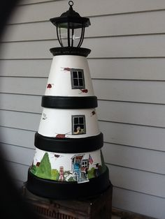 Solar Light House design from clay pots. This would be simple to make from a few old clay pots and a solar light bulb. Flower Pot Art, Clay Flower Pots, Flower Pot Crafts, Clay Pot Projects, Clay Pot Crafts, Diy Clay, Shell Crafts, Flower Pot People, Clay Pot People
