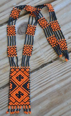 Amazing rare art deco loomed sead bead beaded flapper necklace in orange and black Beaded Jewelry Patterns, Beading Patterns, Art Deco, Herringbone Necklace, Beaded Crafts, Beaded Purses, Loom Beading, Beaded Embroidery, Crystal Beads