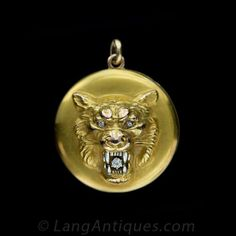 Lion with white gold teeth and fangs bared to reveal an old European cut diamond and diamond-set eyes. Early 20th century.