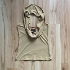 Cowl Neck Halter Top Halter has large cowl design. Open back. Gently used. It's more of. Golden camel color, couldn't get a good picture to show true color.  Cute cut outs in V-neck. Last pic is similar to what it looks like on...minus the sleeves. Tops Blouses