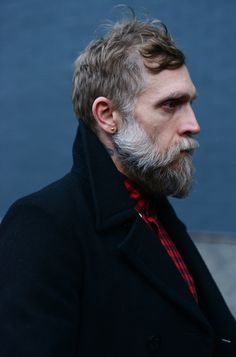 The beard anatomy of Phillip Crangi: friendly muttonchops attached to a moustache undercut to stand out from the full beard below. Beautifully cut.