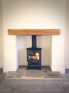 C-Four, oak fireplace beam, reclaimed Yorkshire stone hearth.Charnwood C-Four, oak fireplace beam, reclaimed Yorkshire stone hearth. Wood Burner Fireplace, Small Fireplace, Fireplace Hearth, Wood Mantle, Wood Burner Stove, Floating Fireplace, Cottage Fireplace, Inglenook Fireplace, Fireplace Shelves