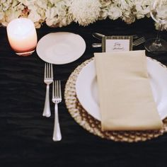 The amber glow of the candlelight with the classic black and white elements makes the table look not only modern and elegant, but warm and inviting as well | Real Wedding: Gary Ireland and Gilbert Archuleta | Photo by: James Moes | Seattle Met Bride and Groom W/S 13
