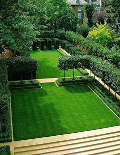 Yew cubes, pleached hornbeam, and boxwood hedges frame a lawn in London.