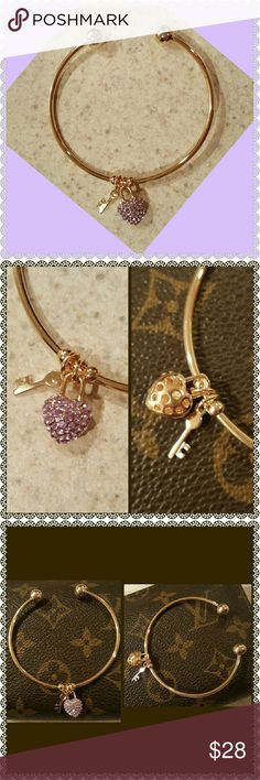 New GP Bracelet w/Lavender Stones & Key Charm Beautiful Open-Ended Gold Plated Bracelet with Lavender Rhinestones on the front of a Heart Charm & a Key Charm!!! Absolutely ADORABLE & prefer to keep for myself, but I'll now have to list everything.  New With Tags Jewelry Bracelets