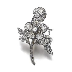 Diamond brooch, late 19th century and later Designed as a floral spray, the central flower set en tremblant, set with cushion-shaped and circular-cut diamonds, later brooch fitting.
