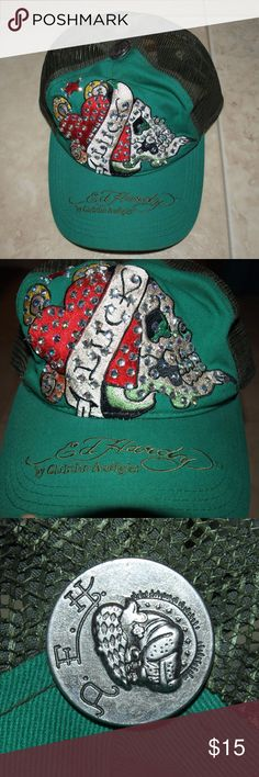 "$5 Ed Hardy blinged hat Very cool design. Like new condition.  ✔The price in the beginning of the title of my listings is the bundle price. These prices are valid through the ""make an offer"" feature after you create a bundle. These bundle orders must be over $15. Ask me about more details if interested.  ❌No trades ❌No holds Ed Hardy Accessories Hats"
