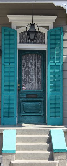 Turquoise Shutters - I loved this so much I had fluer de lis shutters painted this color for the side entrance