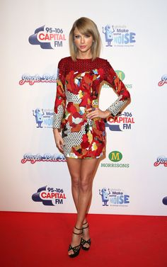 Taylor at the 2014 Capital FM Jingle Bell Ball wearing a Sachin & Babi dress, Charlotte Olympia sandals, and Carla Amorim and Sethi Couture rings.