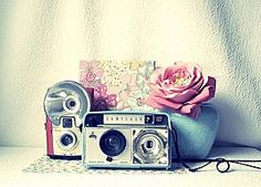 This captures so many things I love: the soft-wash quality, vintage cameras, blues and pinks - just perfect.
