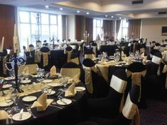 Black Tablecloths, Gold Runner, Gold Sash