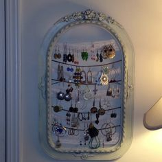 Upcycled flea market frame dressed with lace and leather to hold earrings