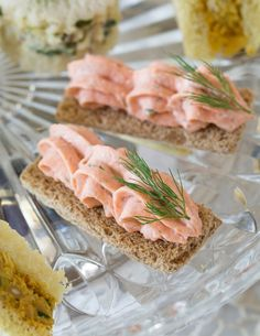 Scrolls of salmon mousse piped onto toasted bread make an elegant canapé in Dilled Salmon Mousse Canapés.