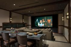 With a movie theater atmosphere and all the comforts of home, this media room allows for ultimate relaxation under the stars — with a snack bar included.