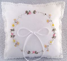 A wonderful summery ring pillow, using both hand and silk ribbon embroidery techniques  A beautiful and unique pillow designed to represent an