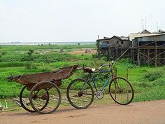 "Picture of bike with trailer, ""common in Cambodia. [Trailer] can hold a passenger or two."""