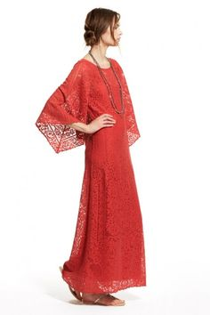 Gwendel Allover Lace Caftanloral lace caftan.  Constructed of a feminine floral patterned lace and lined in a soft jersey tank slip.  Kimono-like sleeves. Calypso st barth