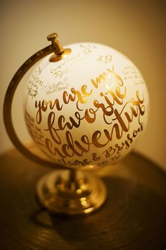 Gold and White Calligraphy Globe for a Travel Themed Wedding Guestbook | Limelight Photography on @myhotelwedding via @aislesociety