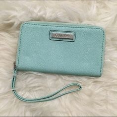 Calvin Klein Aqua Leather Phone Wallet Mint condition (pun intended) aqua/mint colored leather phone wallet/wristlet from Calvin Klein. Only used a few times, no visible flaws. Phone pocket best fits an iPhone 5 or smaller, or can be used to store cash, receipts, or all those random little papers that float around. Gorgeous saffiano textured leather! Color is true in pictures. Calvin Klein Bags Wallets