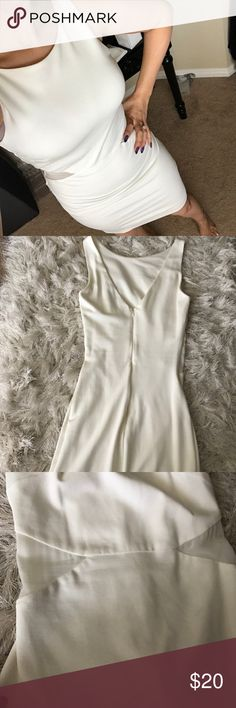 Zara dress Really nice and chic. Mesh detail on sides as shown in photos.Can dress up or down. Form fitting. Color is an off white/cream. This dress also has a built in slip as shown in photos so you don't have to worry about it being see through!! 82% viscose 15% nylon Zara Dresses Midi