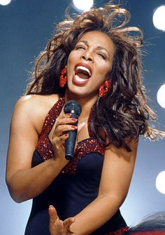 Remembering #DonnaSummer: The singer took the stage in navy dress with beaded maroon trim and matching earrings. Loose waves finished the look. news.instyle.com/...