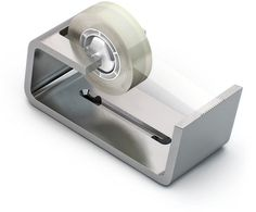 Dispensum tape dispenser. Designed with the elegance of simplicity—it is made of a single bent and burnished metal sheet.It has sockets for inserting a roll of tape and a sharpened edge for cutting it. Dispensum is nicely heavy with an addition of rubber bottom to avoid sliding.http://www.artlebedev.com/everything/dispensum/