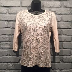 Tahari metallic t shirt Size medium. Colors are off white and silver. 3/4 sleeves. 100% cotton. Only worn once. Bought at Macy's. Very soft and comfortable. Tahari Tops Tees - Long Sleeve
