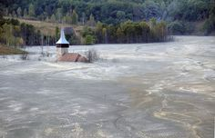 A church drowned within the tailing pond of the Rosia Poieni copper mine next to Lupsa village, 460 km west of Bucharest, Romania, on September 20, 2011
