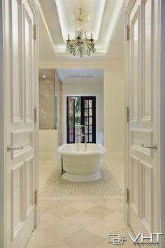 Classy master bathroom with a beautiful chandelier over the bathtub - we love it! Amazing Bathrooms, Master Bathroom, Bathtub, Chandelier, Classy, Beautiful, Standing Bath, Bath Tub, Candelabra