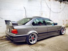 Very nice BMW e36 sedan on Work Equip wheels