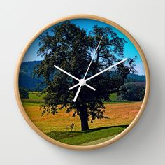 A tree with no name and two chairs Wall Clock