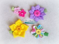 Flower hair clips, the perfect accessory for those spring and summer outfits.  Great for big or little girls alike, or the grown up girls as well.  #ellabellabows #mmmakers #flower #hairbow #hairclip #ribbonsculpture