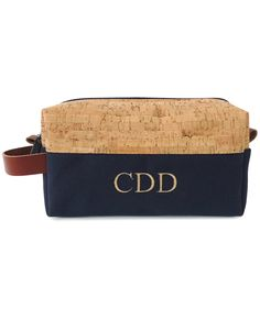 This monogrammed dopp kit is all about rugged sophistication. The toiletry case is accented with cork, which happens to be the material of the moment, combined with canvas and leather. At nine inches long, 4.75 inches tall and 3.25 inches wide, the kit can hold full-size supplies, plus a generous helping of travel-size items.