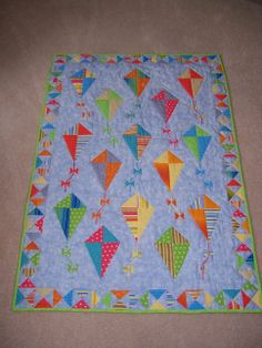 I made this quilt for my grandson Ryan who was born in 2006. The tails of the kites are made with ribbons.