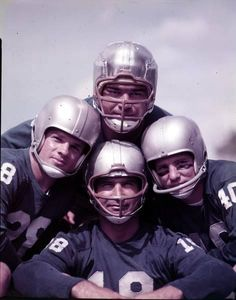 Four members of the Detroit Lions: Charles Ane, Hopalong Cassady, Tobin Rote, and Yale Lary huddle together for a photo in Nfl Football Players, Football Jerseys, Football Helmets, School Football, Nfl Hall Of Fame, Football Hall Of Fame, Nfl Detroit Lions, Detroit Sports, Football Pictures
