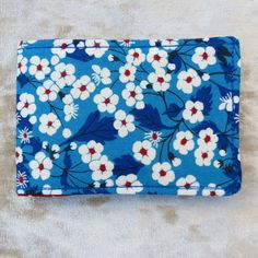 This is a fabric ticket holder. Suitable for Oyster cards, tickets, business cards etc. There are two roomy compartments for cards, one on each side. The fabric used is a Liberty Lawn cotton, with a Mitsi floral design. Oyster Card, Ticket Holders, Oysters, Liberty, Lawn, Floral Design, Cover, Fabric, Sleeves